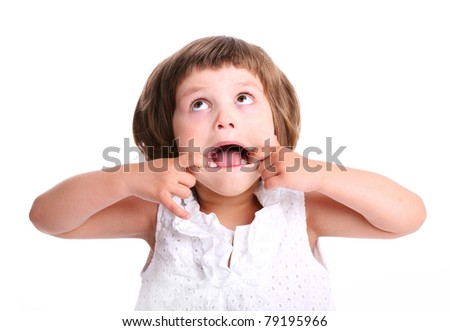 A portrait of a young adorable girl making faces over white background - stock photo