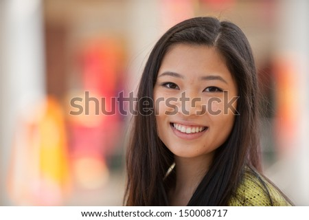 A portrait of a young and beautiful Asian girl - stock photo