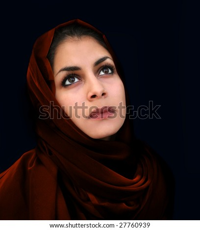 A portrait of a young arab woman in a red scarf - stock photo