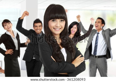 A portrait of a young asian businesswoman leading to success - stock photo
