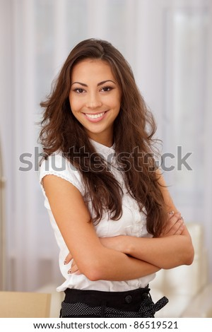 A portrait of a young asian caucasian business woman in an office - stock photo