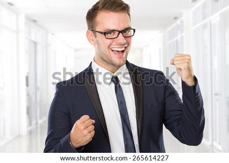 A portrait of a young businessman celebrating victory - stock photo