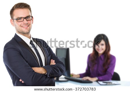 A portrait of a young businessman with business partner at the background - stock photo