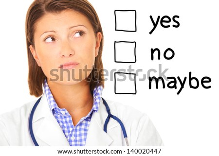 A portrait of a young confused doctor over white background - stock photo