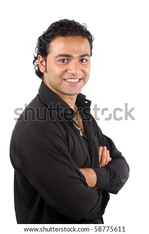 A portrait of a young Indian man, on white studio background. - stock photo