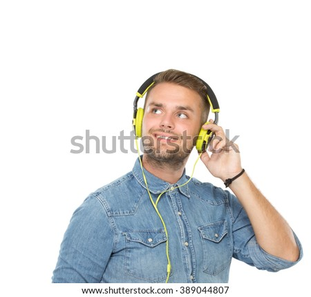 A portrait of a Young man using a earphone, isolated - stock photo