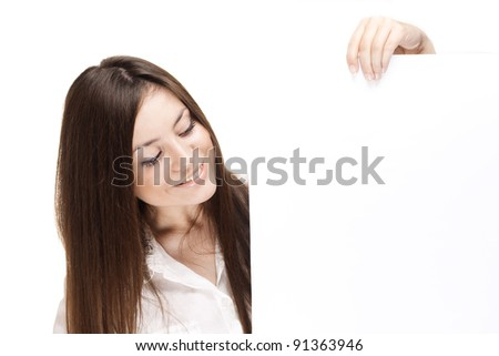 A portrait of a young pretty woman holding a banner - stock photo