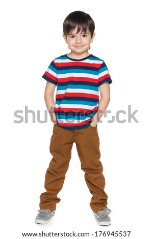 A portrait of a young smiling boy in striped shirt on the white background - stock photo