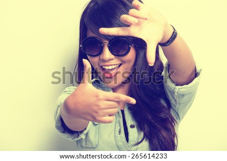 A portrait of a young woman happy posing like capturing a picture isolated - stock photo
