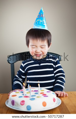 A portrait of an asian boy celebrating his birthday - stock photo