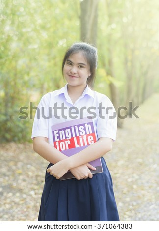 A portrait of an Asian college student - stock photo