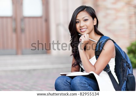 A portrait of an Asian college student at campus - stock photo
