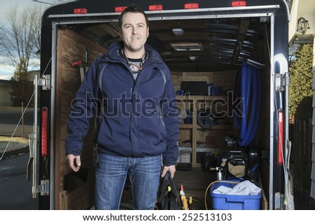 A Portrait of an happy worker with tool - stock photo