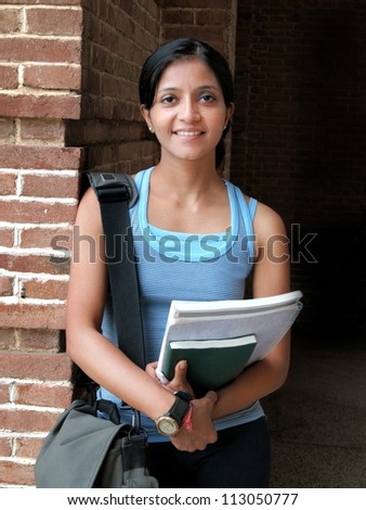 A portrait of an Indian / Asian college student at campus. - stock photo