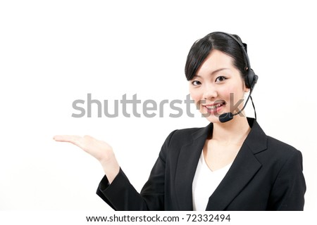 a portrait of asian businesswoman with headset - stock photo