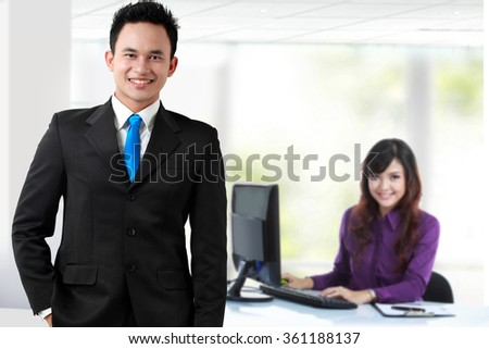 A portrait of asian young businessperson as a team leader. his secretary at the background - stock photo