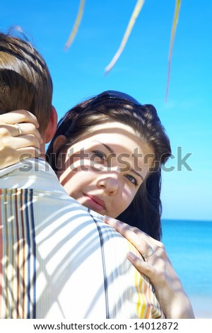 a portrait of attractive couple having date on the beach - stock photo
