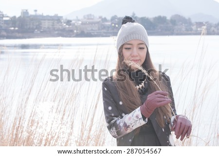 A portrait of beautiful asian woman,Location Kawaguchiko lake,Japan - stock photo