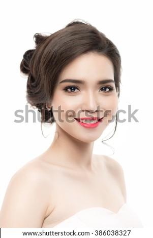 a portrait of beautiful asian woman wearing wedding dress - stock photo