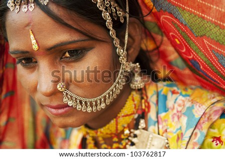 A portrait of beautiful Indian woman, Rajasthan, India - stock photo