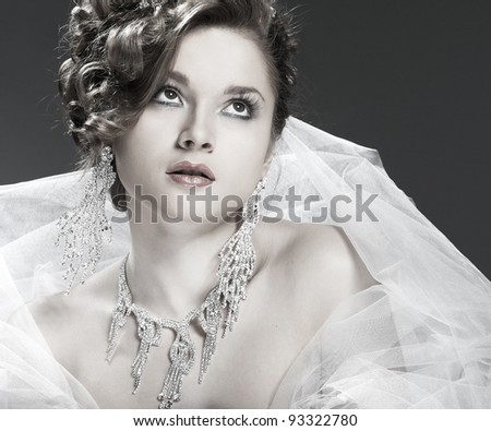 A portrait of beautiful white-headed girl is in weddings accessories wedding decoration - stock photo