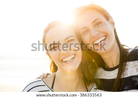 A portrait of best friends laughing  - stock photo