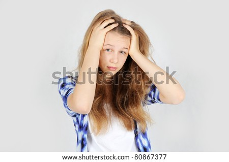 A portrait of Confused teenage girl - stock photo
