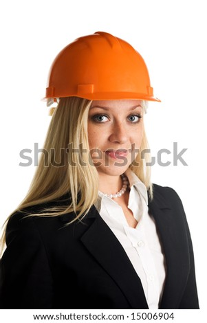 A portrait of freckled woman in hardhat - stock photo