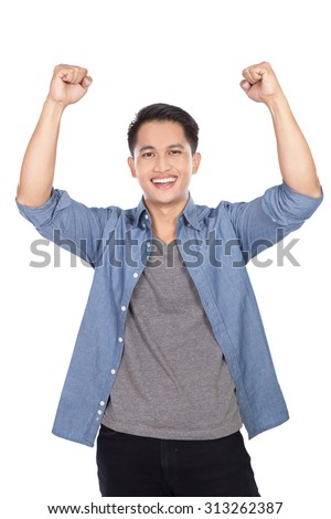 A portrait of happy excited young Asian man isolated on white background - stock photo
