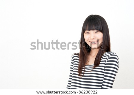 a portrait of pretty asian woman isolated on white background - stock photo