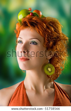 A portrait of red-haired girl with fruits - stock photo