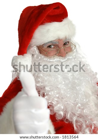 A portrait of Santa Claus giving a thumbs up sign. - stock photo