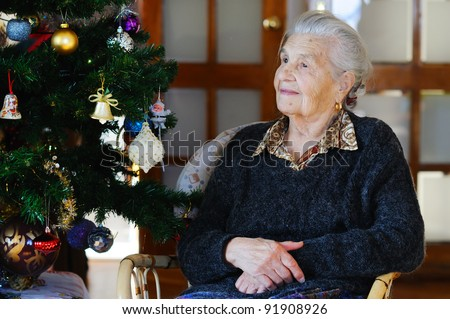 A portrait of senior woman on Christmas day - stock photo