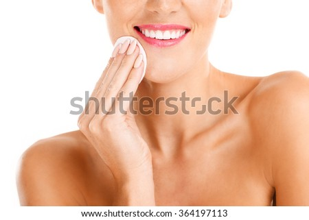 A portrait of sensual woman removing makeup over white background - stock photo
