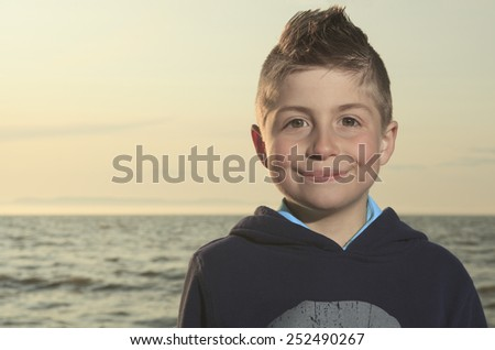 A Portrait of smiling, outdoors at sunset. - stock photo