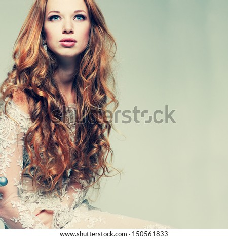 A portrait of stylish elegant redheaded girl is in lace clothes - stock photo