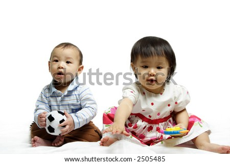 A portrait of two cute babies posing together - stock photo