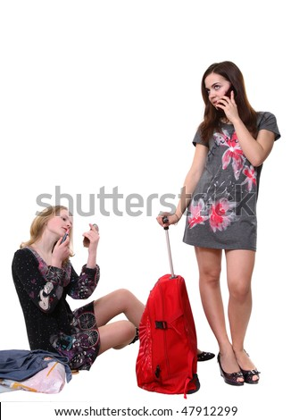 A portrait of two young pretty girls with a big red bag - stock photo