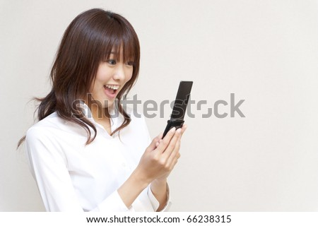 a portrait of young business woman using a cellphone - stock photo
