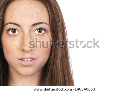 A portrait of young, fresh faced woman with freckles. Natural beauty concept with space for your text - stock photo
