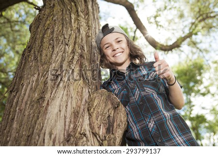 A Portrait Of Young Smiling Teen Boy - stock photo