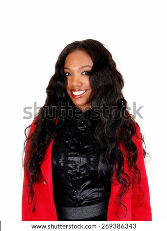A portrait picture of a African American lady in a black blouse