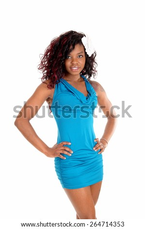 A portrait picture of a young African American woman with curly hair