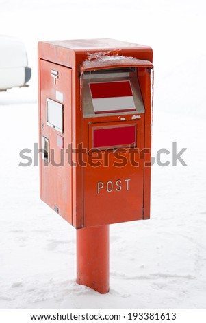 A postbox in the snow - stock photo