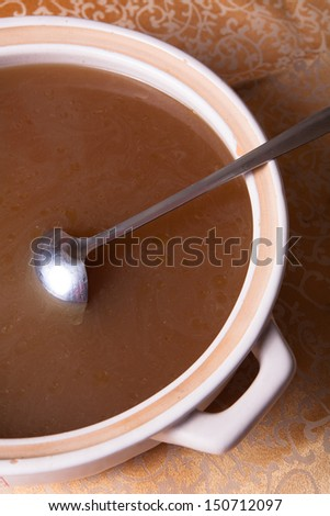 a pot of delicious chicken soup on the table - stock photo