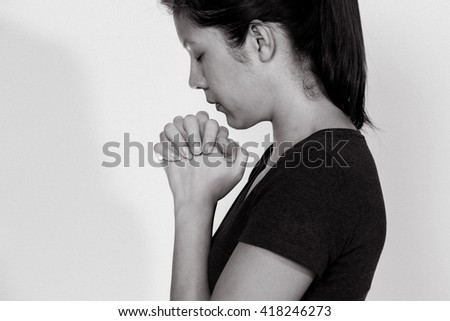 a prayer woman with the white screen - stock photo