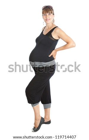 A pregnant woman, 9 months. Isolated on white - stock photo