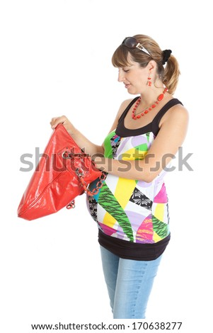 A pregnant woman (9 months) opens a red bag - stock photo