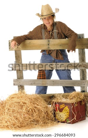 """A preteen """"scarecrow"""" slouching over an old rail fence.  On a white background. - stock photo"""