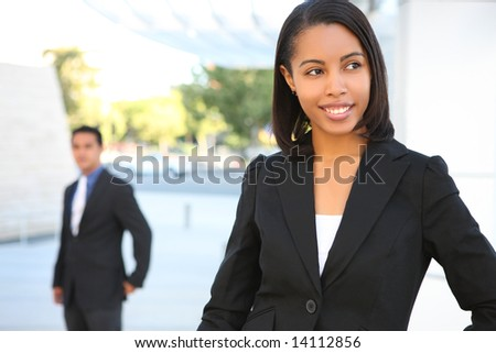 A pretty african american business woman at office building - stock photo